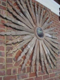 Up-cycle   picket fence for this awesome sunburst!  Gotta make one for my barn!!