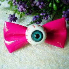 Gothic Kawaii Eyeball Hair Bow - Rebel Style Shop - Bloodshot and still fabulous? It's possible with this cartoon horror eyeball hair bow! Fashioned with candy-coloured bows, there eyeballs really pop and spook anyone out.