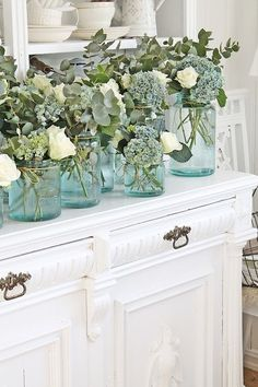 Roses, eucalyptus and hydrangea in vintage mason jars. We have a few blue mason jars but not enough for every table maybe some tables with blue jars and some with clear jars or bottles Vintage Mason Jars, Blue Mason Jars, Mason Jar Flowers, Mason Jar Hydrangea, Farmhouse Interior, Farmhouse Decor, Eucalyptus Centerpiece, Garden Bridal Showers, Vibeke Design
