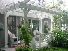 pergola bois - veranda en blanc