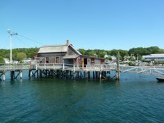 Boothbay Harbor, ME.  Little house in the middle of the footbridge.  It is privately owned and used as a summer home.  Yes please! Photo by J. Underwood.