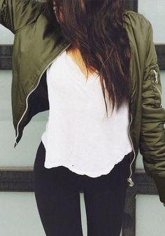 Long nylon bomber jacket with long sleeves with zipper embellishment at left sleeves, micro rib knit trim, zipper closure, zipper waist pockets, zipper detail at back, and drawstring hem. Lined