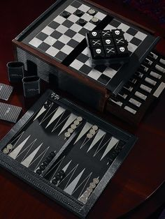 Back to the classics: Our Carbon Fiber 5-in-1 Game Box includes chess, checkers, backgammon, playing cards and tic-tact-toe