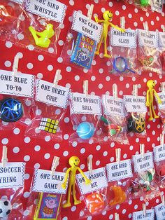 "Circus Party Prize Board display. This is way organized than the ""prize bin"" I've used in the past. And so festive looking!  Circus party prize board ...love this idea."