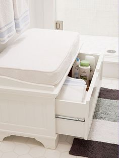A stool isn't just a stool when it comes to small-space storage: Here, it's a spot for extra washcloths and pint-size bathing essentials.