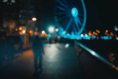 abstract bokeh background of people walk on the waterfront at night