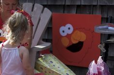 Pin the Nose on the Elmo Birthday Party Game! I think one year olds can do this, right? I mean not blind folded.