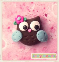 Aw this is so cute a owl clay charm I want to try this