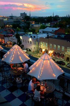 Guests enjoying the beautiful Downtown Charleston sunset atop the Pavilion Bar - Charleston's Premier Rooftop Bar at Market Pavilion Hotel- Charleston's Premier Luxury Hotel
