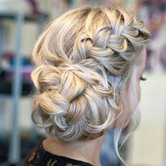 (Maybe Kristy?) Side French Braid bun - this has a link to tutorial, but this pic is much better bc the girl has thick hair, tutorial girl has thin hair.