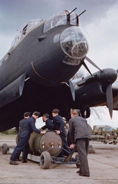 Troops loading a 4000 lb Cookie bomb into a Lancaster bomber. 1940