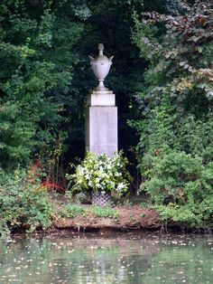 Diana's headstone on the small island where she's buried at Althorp. Her grave can be seen from the banks, but is accessible only to estate caretakers and family via private boat.: