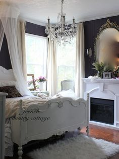 FRENCH COUNTRY COTTAGE: Feathered Nest Friday. Too die for navy blue walls and white trimmed fireplace in historic luxurious shabby classic traditional bedroom. Love love it!!! Do you like this clean stark contrast