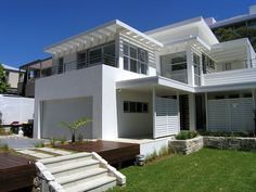 Along with old world-esque charming victorians, colonials, and cottages...i love Modern houses.