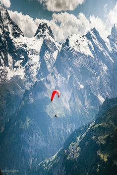Paragliding in the Dolomites, Italy. Actually paragliding anywhere with snowcapped mountains will be just as thrilling.