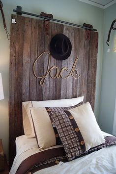 Here's a boy's headboard made with old wood and personalized with his name written with rope. (western, decor)