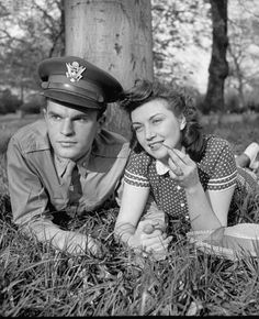 American soldier and girlfriend holding hands. 1943.