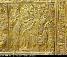 Stock Photo: Detail of the exterior of the gilt shrine showing the queen fastening a necklace around the king's neck, from the tomb of the pharaoh Tutankhamun.