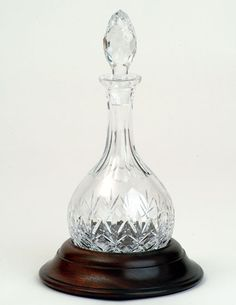 Hogget Decanter Cut Crystal with Hardwood (Sapele) Base - Bottle - Item 1042 -Very appropriately named, the Hoggett Decanter has a rounded base and comes with a round wooden stand in which it sits.
