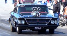 This Blown 1964 Chrysler 300 not only looks wicked, but it lifts the front wheels in the air. Watch the video!