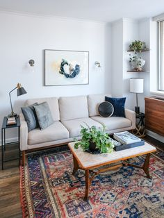 """""""It was a condo with no charm or details and in need of some upgrades. There were stains on the walls and ceiling, the floors were badly damaged, the wood veneer was peeling off the kitchen cabinets, and the bulky AC units were the focal point of each room."""""""