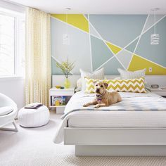 Painted geometric wall treatment Geometric, Bold, Bright, Contemporary, Linear Team this funky wall design with some bold geometric fabric prints to give a vibrant, contemporary feel.