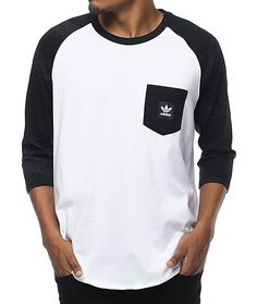 The Word Camo White and Black Baseball T-Shirt has a classic baseball tee composition with the touch of class only adidas could offer. The garment has raglan sleeves, a front left chest pocket, and a rounded bottom hem. The raglan sleeves are marked with