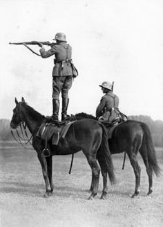 Ww2 • German soldiers on horses shooting