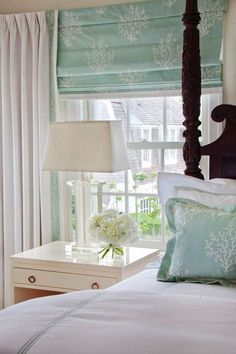 Sea glass colors soothe the heart and mind. I love how the shade and the pillow match cute guest room?