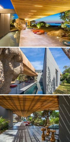 This modern villa has pergola with a long pool that runs alongside it, and a large rock formation has been left in place, and everything has been built around it.