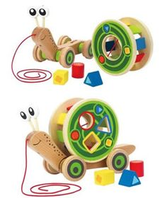 Hape Walk Along Snail - this clever toy is much more than just a pull along snail! It's also a shape sorter which can played with alone, the shape sorter is also a 'rolling' toy.  The snail's shell rolls around as it's pulled too - fantastic! #HapeToys