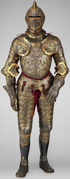 Armor of Henry II of France, detail view, ca. 1555, steel, embossed, blued, silvered, and gilt, one of the most elaborate and complete French parade armors, retains much of its original coloring. The surfaces are covered by dense foliate scrolls inhabited by human figures and a variety of fabulous creatures that derive from the Italian grotesque. The crescent moon, one of the badges of Henry II (reigned 1547–59), appears in several places, 53 lb. 4 oz. (24.20 kg), height, 74 in. (187.96 cm).