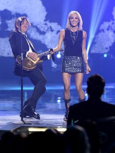 "Keith Urban Photos Photos - Recording artists Keith Urban (L) and Carrie Underwood perform onstage during FOX's ""American Idol"" Finale For The Farewell Season at Dolby Theatre on April 7, 2016 in Hollywood, California. at Dolby Theatre on April 7, 2016 in Hollywood, California. - FOX's 'American Idol' Finale For The Farewell Season - Show"