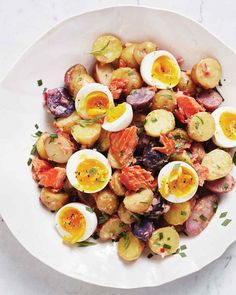 Smoked-Salmon Potato Salad With Eggs and Herbs Recipe | Martha Stewart Living - Flaked hot-smoked salmon stands in for bacon in this twist on an always-popular dish.