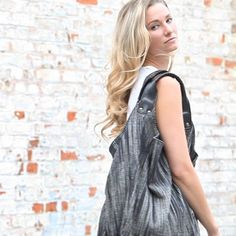 The popular HAVA bag is an oversized casual beach cotton bag with vegan leather woven handles. It has a tie closure inside the bag and two large…