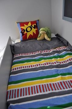 Superhero Room with loft bed and slide.