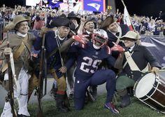 New England Patriots RB LeGarrette Blount celebrates a Week 3 TD with the End Zone Militia. (AP/Krupa)