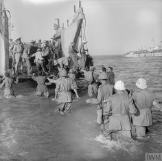 Operation Husky: The Sicily Landings 9 - 10 July 1943: Italian prisoners, captured while manning coastal machine gun posts, board a Royal Navy landing craft before being transported to North Africa.