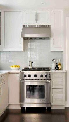 bright & airy - perhaps something like this for the hood in our kitchen.  Definitely taking out the microwave from over the stove.