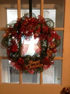 Deco mesh Christmas wreath made by Debbie Snyder.