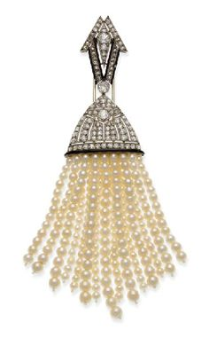 CLIP EMAIL, DIAMONDS AND PEARLS BY CHAUMET  Has a rhombic pattern set with old-cut round diamonds lined with black enamel lines holding a pendant dome after fifteen tassels decorated 237 beads measuring 5.5 mm to 3.5 mm diameter platinum setting, circa 1930, in its case  Bears the hallmark of Chaumet.