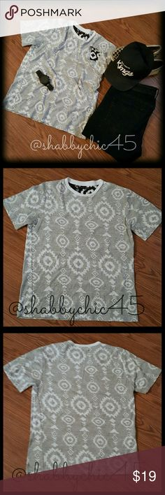 🐶HP🐶 EUC Simen (Nordic) Trendy Inside-Out Tee Nordic clothing is now the go to street wear for the fashion conscious twenty something. Leading the edgy side of design,  this t-shirt is made to look inside out.  Dark black and white tribal design on the inside creates a muted gray color combination design on the outside.  Goes great with distressed jeans,  joggers or shorts. PRICE IS FIRM.     💘Smoke free home. No trades. Open to reasonable offers unless marked as firm. Happy Poshing!!💘…