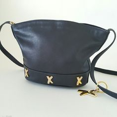 "Paloma Picasso Crossbody  Black Bag. One day Sale Beautiful vintage bag from Paloma Picasso 100% authentic, black  leather, signature lining, zippered closure, zippered pocket interior. Great condition except the gold X some small discoloration overall looks beautiful. Dimensions are 11"" x 8"" x 4"" Strap drop 24"" Paloma Picasso  Bags Crossbody Bags"