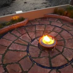 Landscape Backyard Fire Pit Design.  I want to do this in red and yellow.  Why yes I do want to recreate The Wizard of Oz in my back yard.