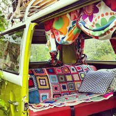 Camper with crochet blankets.