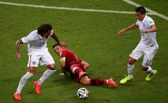 U.S. Stunned By Last-Minute Portugal Goal In World Cup Thriller - MANAUS, BRAZIL - JUNE 22: Cristiano Ronaldo of Portugal is challenged by Jermaine Jones (L) and Alejandro Bedoya of the United States during the 2014 FIFA World Cup Brazil Group G match between the United States and Portugal at Arena Amazonia on June 22, 2014 in Manaus, Brazil. (Photo by Elsa/Getty Images)