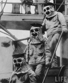 Sailors aboard an Austrian warship wearing protective suits and gas masks during World War I, 1916.