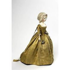 This doll from the 1740s looks like she has the figure of an adult woman.  However, based on the style of the gown with leading strings at the back, the doll represents a child.  Another pretty damask gown.