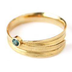 a ring I would actually wear. Meadowgrass Blue Topaz ring by Alex Monroe.