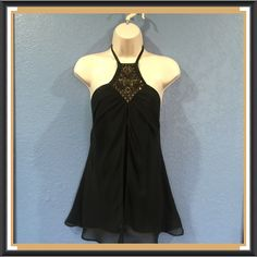 EXPRESS Black Silk Halter. NWT. 100% silk black halter. Neckline is adorned with copper & gold beads & sequins. Extras provided in a bag. But none are missing. Beautiful fit with sheer layering of fabric splitting at the front and falling in a most flattering way. See pic #2.  NWT $60 Express Tops Tank Tops